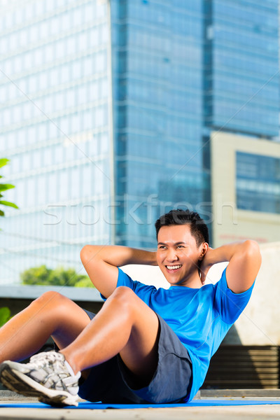 Urban sports - fitness in Asian or Indonesian city Stock photo © Kzenon