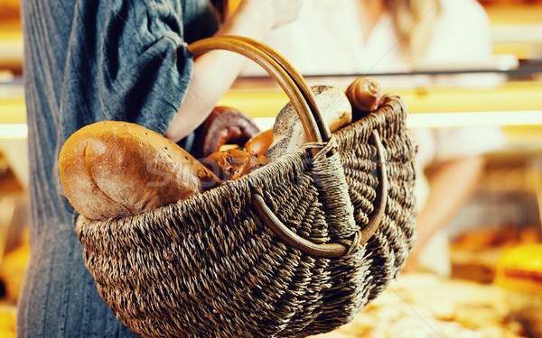 Customer shopping bread in baker carrying basket Stock photo © Kzenon