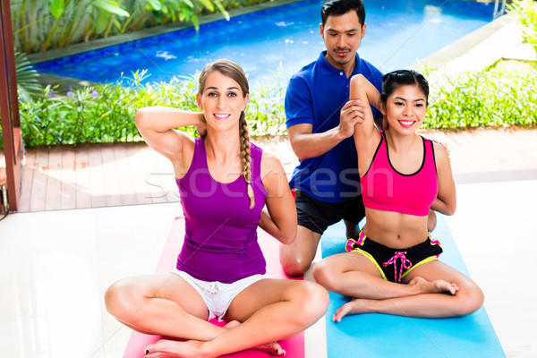 Women and personal trainer at fitness exercise Stock photo © Kzenon