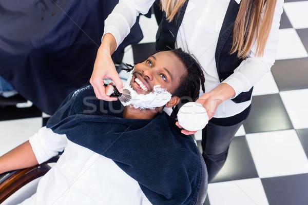 Customer at barber shop with shaving cream Stock photo © Kzenon