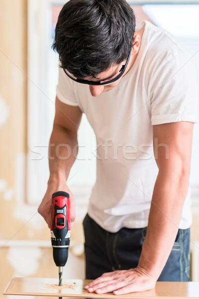Kézműves csináld magad férfi dolgozik erő fúró Stock fotó © Kzenon