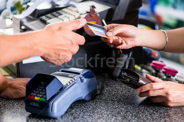 Credit card payment at terminal in shop Stock photo © Kzenon