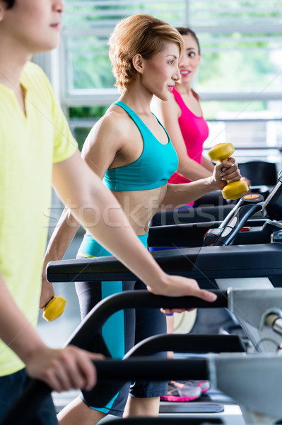 Supervision of sportive people training on treadmill Stock photo © Kzenon