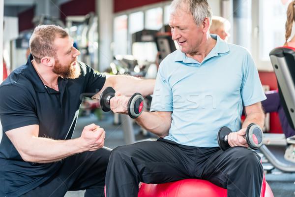 старший человека Личный тренер спортзал фитнес Сток-фото © Kzenon
