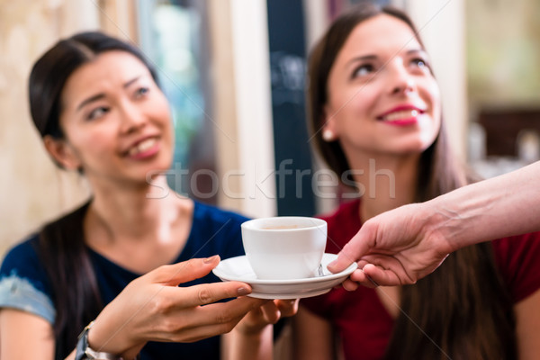 White cup of coffee served to female customers Stock photo © Kzenon