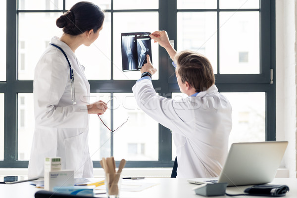 Experienced orthopedist helping his colleague with the interpret Stock photo © Kzenon