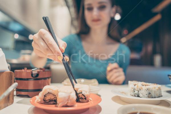 женщину еды суши продовольствие Японский ресторан Сток-фото © Kzenon