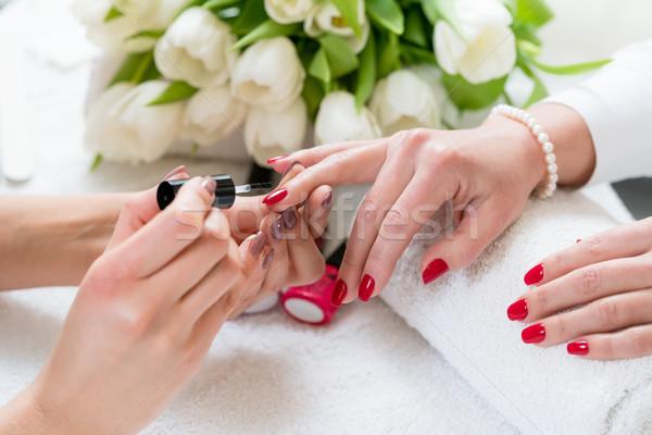 Mãos hábil vermelho unha polonês Foto stock © Kzenon