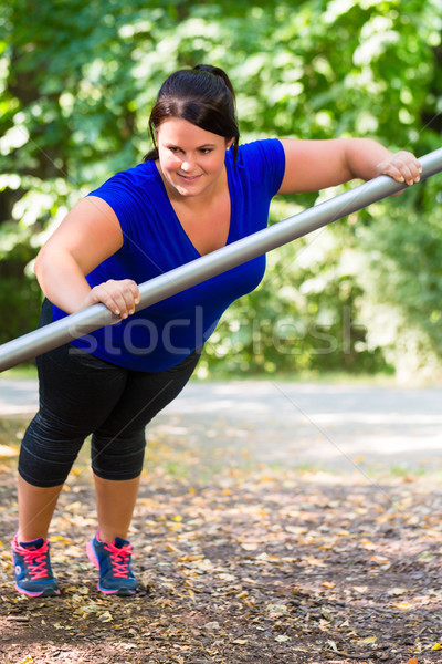Obèse femme sport extérieur parc Photo stock © Kzenon