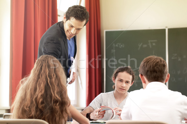 Stock photo: Teacher teaching or educate at the board a class in school