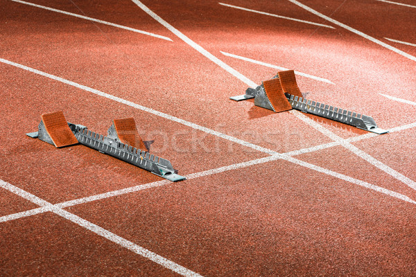 Starrting blocks at cindertrack of athletics stadium Stock photo © Kzenon