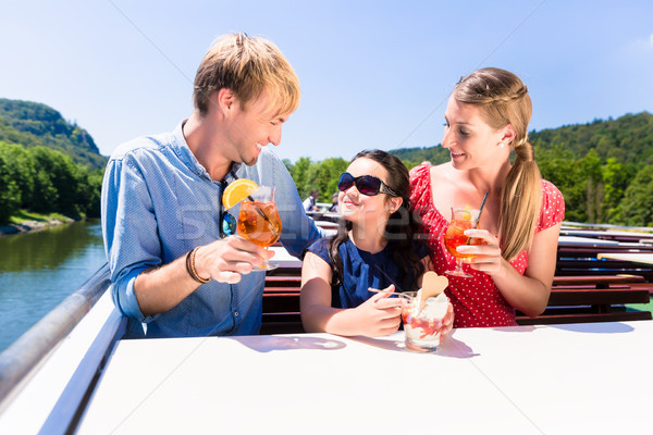 Family at lunch on river cruise with beer glasses on deck Stock photo © Kzenon
