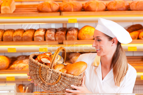 Female baker selling bread in her bakery Stock photo © Kzenon