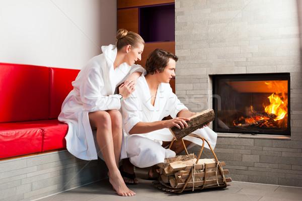 座って バスローブ オープン 暖炉 女性 ストックフォト © Kzenon