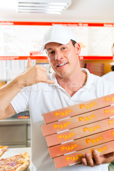 Stock photo: Delivery service - man holding pizza boxes