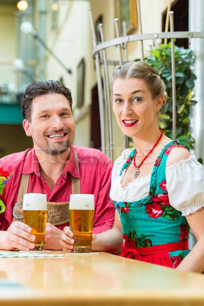 Young couple in Bavaria in restaurant or pub Stock photo © Kzenon