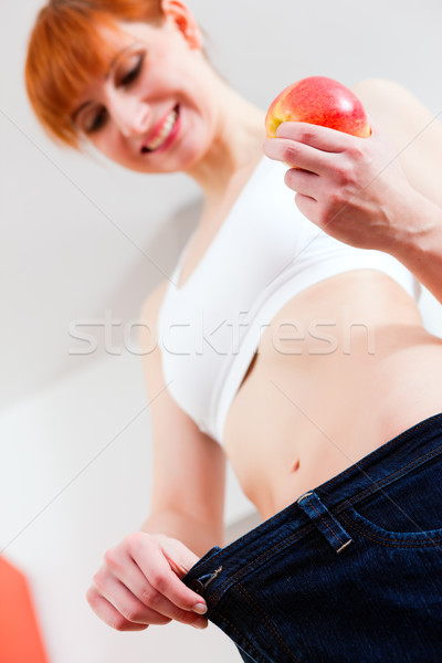 woman on diet with oversized pants Stock photo © Kzenon