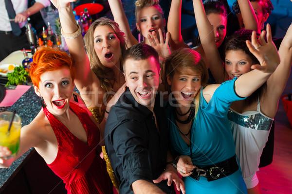 Młodych ludzi taniec klub disco mężczyzn kobiet Zdjęcia stock © Kzenon