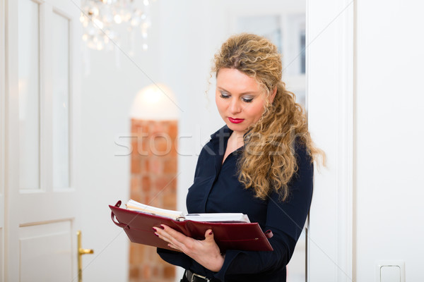 After Hour - woman at home with address book Stock photo © Kzenon