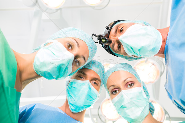 Surgeons operating patient in operation theater Stock photo © Kzenon