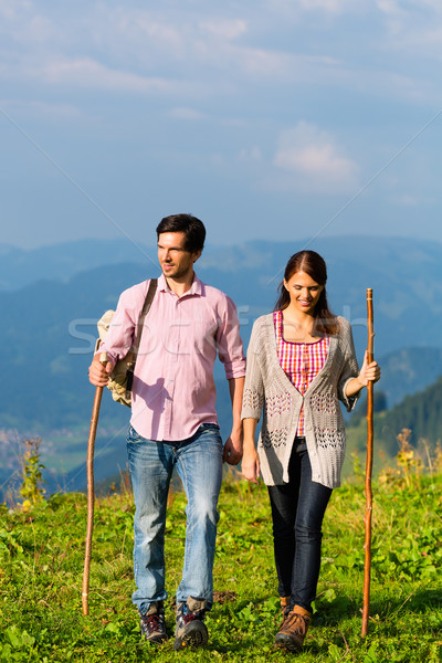 Hiking vacation - man and woman in alp mountains Stock photo © Kzenon