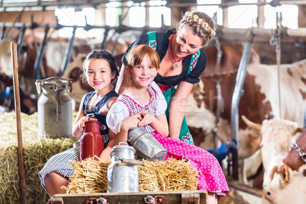 Bavaria family driving pushcard in cow barn Stock photo © Kzenon