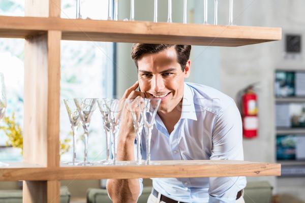 Man in furniture store talking on phone Stock photo © Kzenon