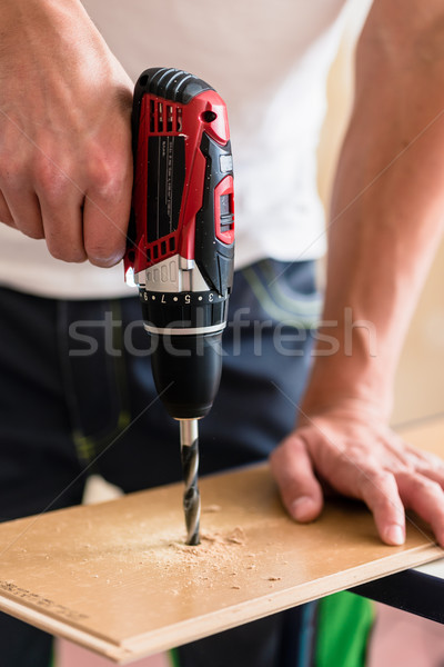 Craftsman or DIY man working with power drill Stock photo © Kzenon