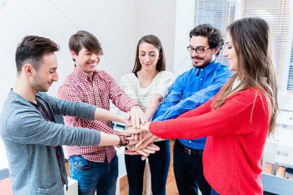 Students in university or college cling together Stock photo © Kzenon