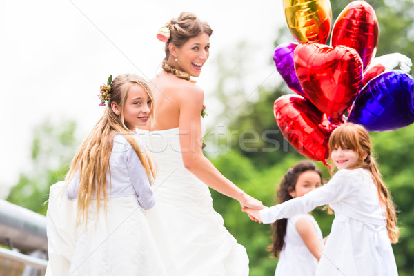Wedding Bride in gown with bridesmaid Stock photo © Kzenon