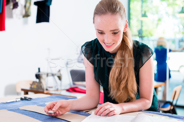 Tailor transfers pattern of fashion design to cloth Stock photo © Kzenon