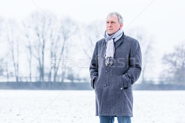 Deprimido triste hombre caminando invierno solo Foto stock © Kzenon