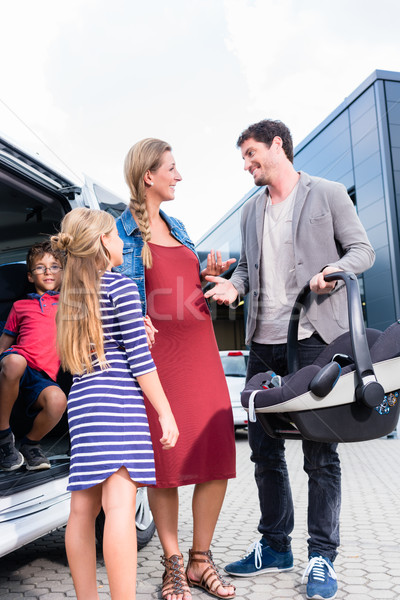 Family checking new car in car dealership Stock photo © Kzenon