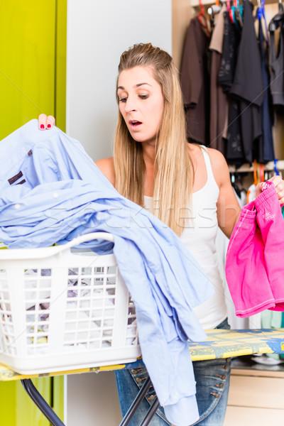 Nő ruhásszekrény hálószoba szennyes fiatal nő család Stock fotó © Kzenon