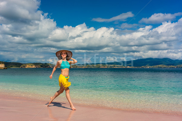 Fashionable young woman enjoying happiness and freedom while wal Stock photo © Kzenon