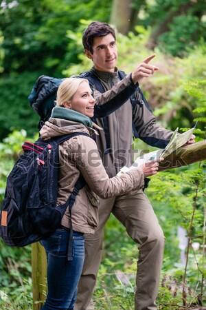Hiker taking food break in shade of tree Stock photo © Kzenon
