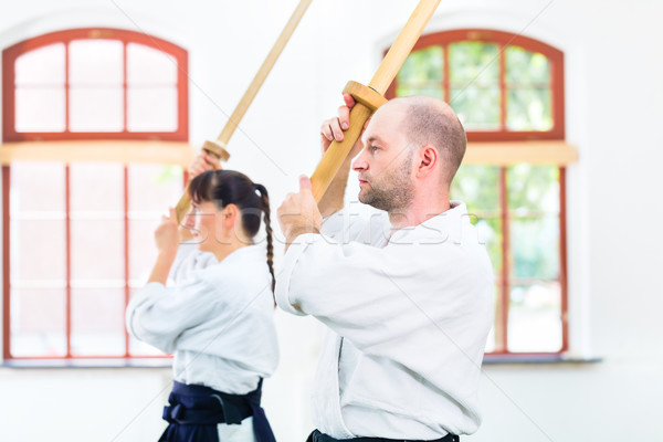 Man and woman having Aikido sword fight Stock photo © Kzenon