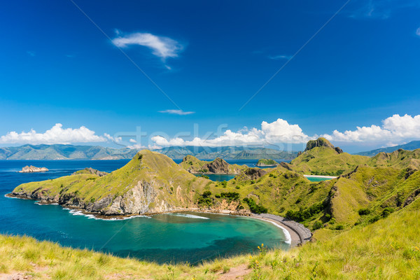 Idyllic seascape from Indonesia with the coastline of Padar Isla Stock photo © Kzenon