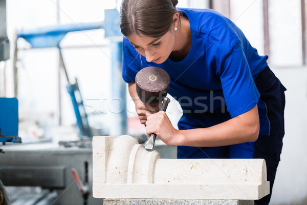 woman Stonemason carving pillar out of stone in workshop Stock photo © Kzenon