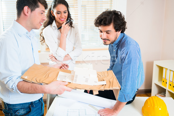 Construction engineers and architects discuss building Stock photo © Kzenon