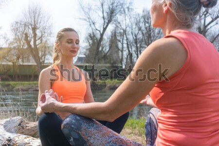 Senior and young woman resting on log after sport Stock photo © Kzenon