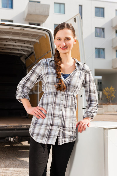 Woman in front of moving truck Stock photo © Kzenon