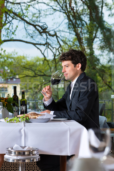 Businessman has lunch in restaurant Stock photo © Kzenon
