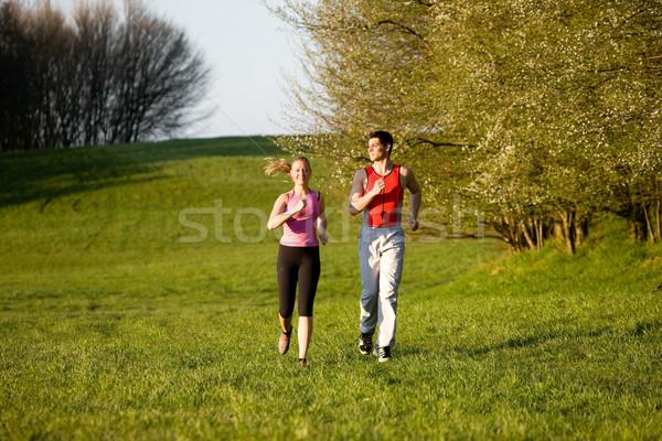 Couple Jogging for sport outdoors  Stock photo © Kzenon