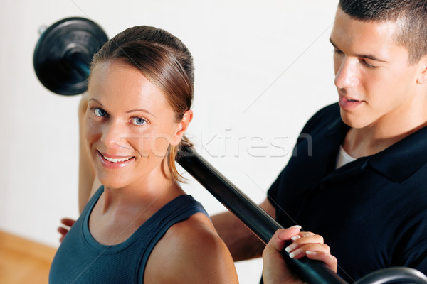 Stock photo: Personal Trainer in gym