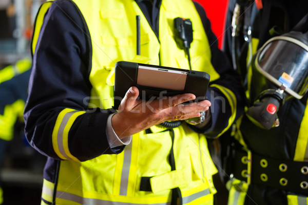 Fire brigade deployment plan on Tablet Computer Stock photo © Kzenon
