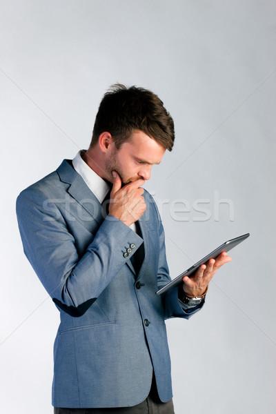 Businessman using tablet computer Stock photo © Kzenon