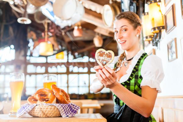 Woman in Bavarian restaurant with gingerbread  Stock photo © Kzenon