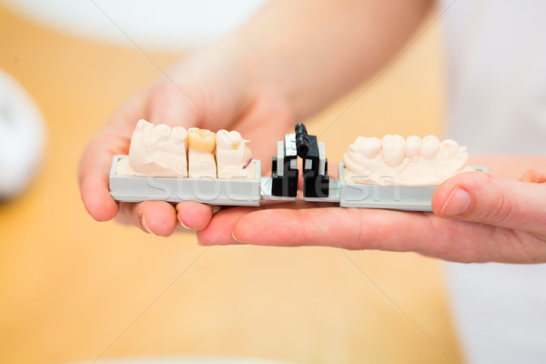 Dental technician checking denture Stock photo © Kzenon