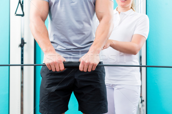 Physiotherapist working with patient in practice  Stock photo © Kzenon